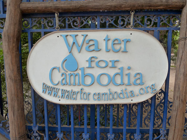 water for cambodia sign on gate of office at lab