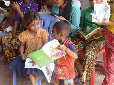 young children sharing book